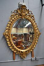 Antique French oval gilt surround mirror, approx