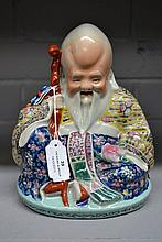 Chinese porcelain figure of a Lohan, 19cm high