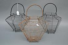 Three vintage French wirework egg baskets, 31cm