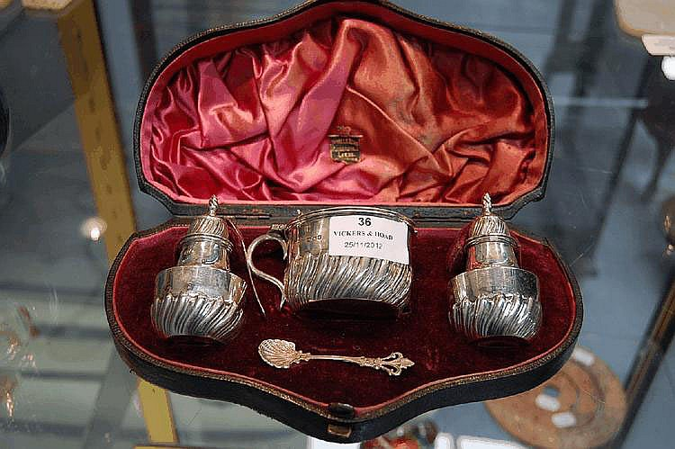 Sterling silver cased muffineer set in