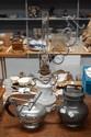 Pewter lidded pot, teapot and an oil lamp