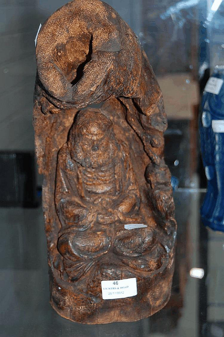 Naturalistic carved bamboo, carved with a seated