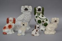 Six antique Staffordshire dogs of various size & colours, approx 27cm H and