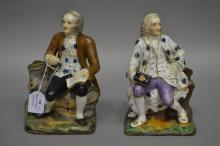 Pair of Antique Staffordshire figural spill vases of two seated gentlemen,
