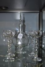 Glass decanter with twist design along with four matching glasses, approx 2