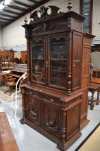 Antique French Renaissance style buffet bookcase, carved in high relief wit