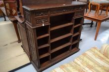 Antique French carved oak open shelf floor bookcase, with drawers above, ap