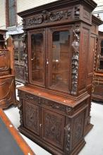 Antique French renaissance revival carved oak bookcase, carved in high reli