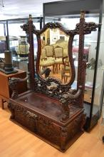 Antique Japanese red lacquer and carved wood mirrored back bench, dragon he
