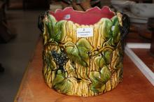 Antique Majolica jardiniere decorated with bunches of grapes and black lizards in relief, approx 20cm H x 20cm dia
