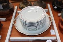 Limoges dessert service comprising of serving plate and eleven plates (12)