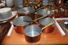 Set of five graduating French copper saucepans, approx 40cm L and smaller (5)