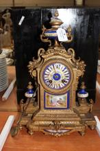 Antique French mantle clock with porcelain insert panels and decoration, marked for Paris, has key (in office) and pendulum, approx 39cm H