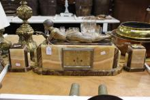 Art Deco mantle clock & garnitures, of a lady laying down with a ball, no key or pendulum, approx 48cm L x 32cm W (3)