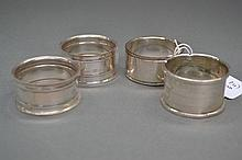 Three silver and one silver plate napkin rings (4)