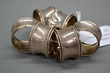 Set of six silver napkin rings marked 800