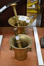 Two antique bronze mortar and pestles of similar