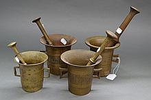 Group of four mortars and pestles of varying