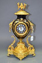 Antique French gilt metal and porcelain clock, the