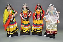 Four decorative Indian dolls