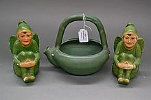 A pair of vintage elf bookends and a teapot