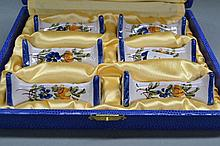 Cased set of French Faience knife rests