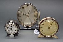Two Westclox clocks and another (3)