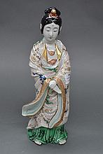 Porcelain enamelled figure of a Japanese lady,