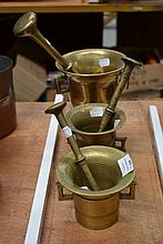 Three antique bronze ringed mortar and pestles of