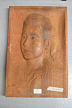 Carved wooden portrait of a young girl, monogram