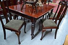 Antique mahogany two leaf extension dining table