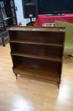 English mahogany Regency style open tiered floor bookcase, turned legs supports, with makers plaque Redman & Hales LTD Essex England', approx 105cm H x 95cm W x 25cm D