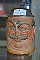 Antique German character faced stein