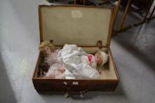 Vintage leather suitcase with a Armand Marseille doll and another