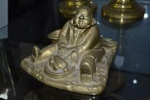 Antique bronze inkwell of a man carving a turkey, approx 11cm H x 15cm W