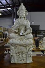 Large Chinese celadon glazed porcelain figure of a seated Gyan Yin, seated on a lotus base with figures and lily pads below, approx 98cm H