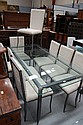Glass topped dining table with eight chairs