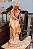 A antique French terracotta figure of Venus