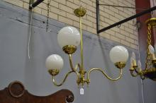 Polished brass three light chandelier with glass ball form shades