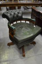 A good vintage leather upholstered swivel desk chair, button back and loose leather seat, spindle gallery back