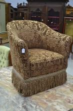 Horse shoe shaped upholstered arm chair