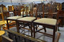 Three antique English Georgian shaped and pierced back chairs, all standing on square chamfered legs (3)
