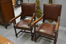 Pair of antique period carved oak Renaissance style arm chairs, carved with winged putti to the arm ends (2)
