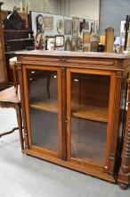 Good quality vintage French walnut two door bookcase/ display cabinet, fitted with two lift up tops. Makers Label to back, approx 34cm H x 126cm W x 38cm D