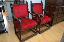 Pair of Antique French red upholstered armchairs, each carved with rams heads to the arms (2)