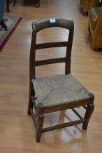 Antique French early 19th century walnut child's chair with rush seat