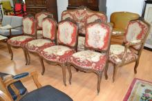 Antique French Louis XV style carved walnut seven piece suite, comprising a settee, pair of arm chairs, and four side chairs, all with needlework upholstery (7)