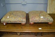Pair of paisley upholstered footstools with bun feet, approx 38cm x 38cm square