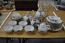 A Japanese export part tea service decorated with Japanese family near a la