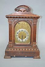 Antique musical chiming walnut cased bracket clock, fitted with an arched d